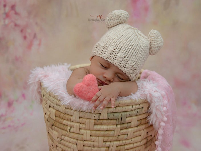 delhi gurgain baby photography baby sleeping in a basket with white cute cap meghna rathore photography