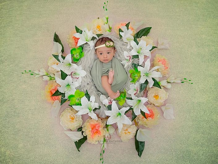 delhi gurgaon newborn professional photo shoot baby in a basket with flowers around meghna rathore photography