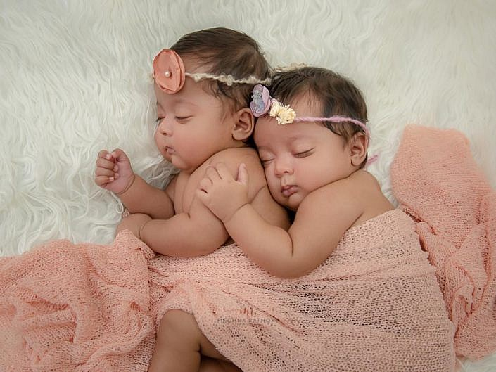 delhi newborn baby photoshoot twin babies hugging each other and sleeping meghna rathore photography