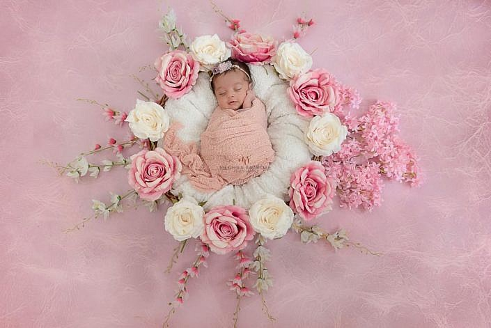 Meghna Rathore Photography, newborn girl in basket, pink flowers, newborn photographer