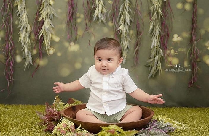 Meghna Rathore Photography, baby in sitter bowl, garden theme