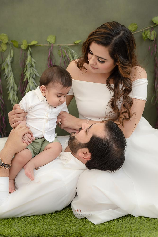 Meghna Rathore Photography, garden theme, family love, white dress, mother and father posing