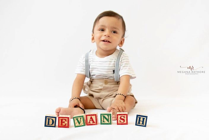 Meghna Rathore Photography, kid posing, baby smiling, wooden alphabets blocks