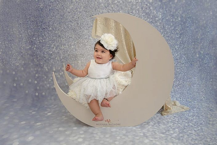 Meghna Rathore Photography, baby on moon prop