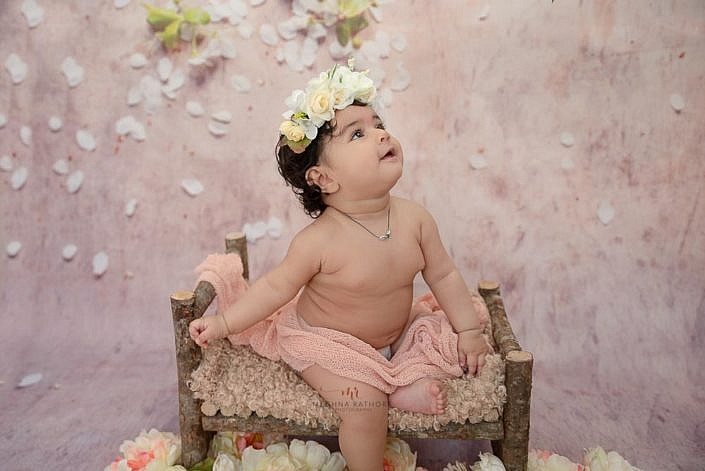 Meghna Rathore Photography, baby on wooden log bed