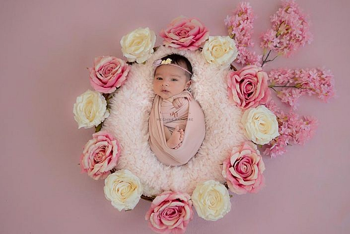 Meghna Rathore Photography, baby in pink basket, pink flowers