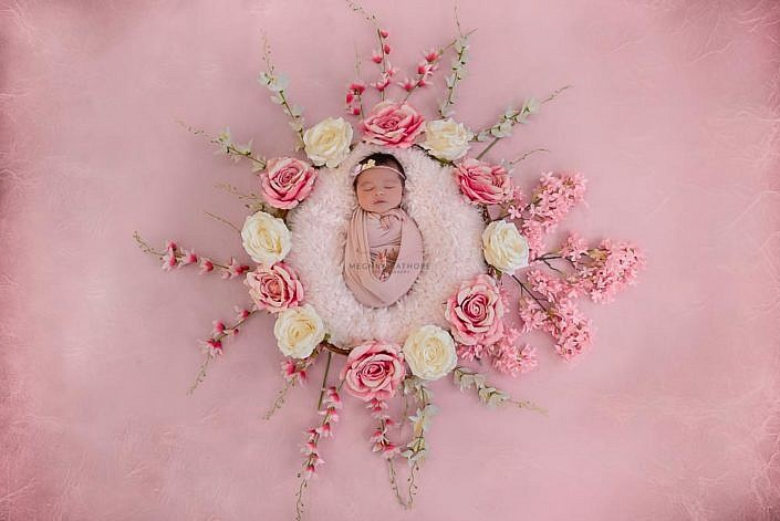 Meghna Rathore Photography, baby pose in basket, pink flowers