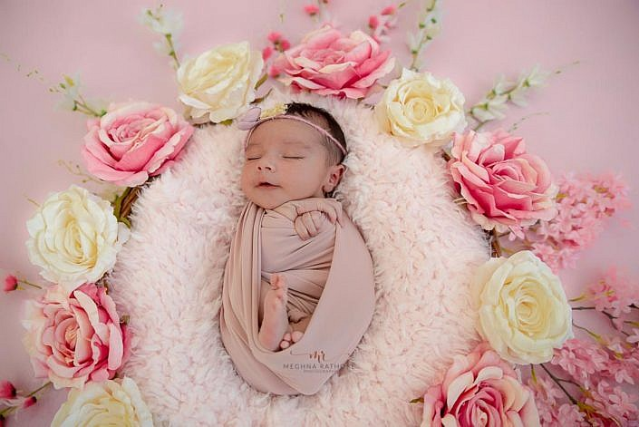 Meghna Rathore Photography, newborn posing in basket, pink flowers