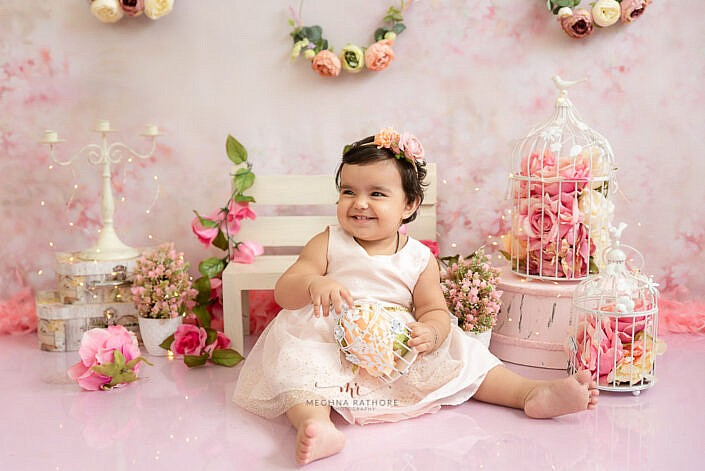 baby girl smiling white dress floral head band professional girl photo shoot Meghna Rathore Photography