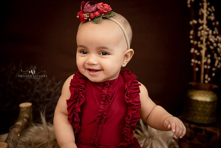 baby girl smiling close up professional photo shoot Meghna Rathore Photography