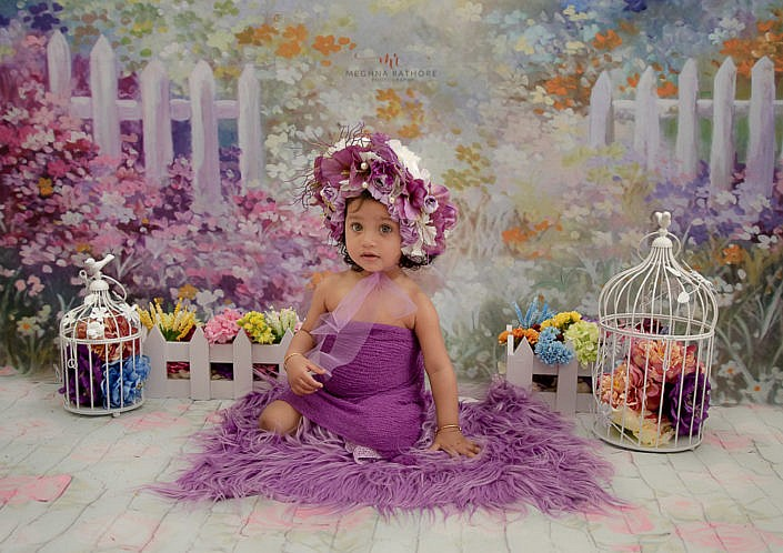 meghna rathore photography delhi kid photo shoot girl kid in purple dress and matching head band with cute purple backdrop