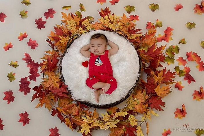 Meghna Rathore Photography, baby sleeping in basket, fall colors