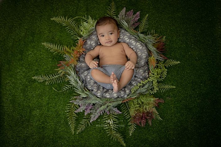 Meghna Rathore Photography, baby in basket, green plants