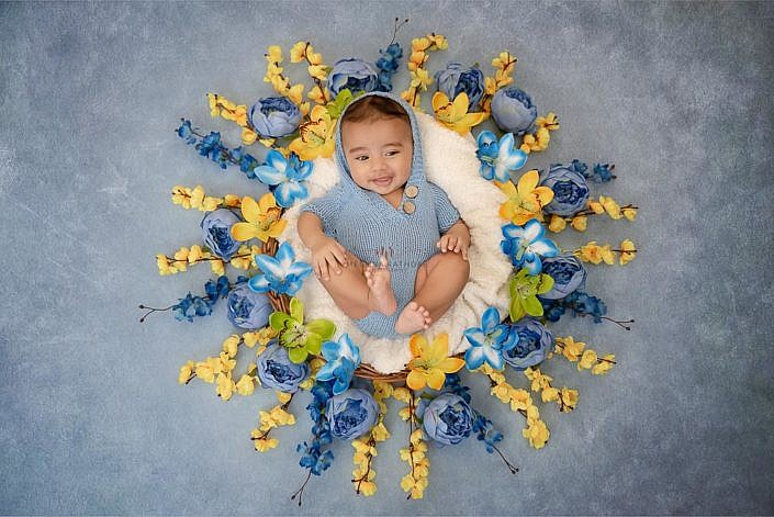 Meghna Rathore Photography, baby in basket, blue flowers