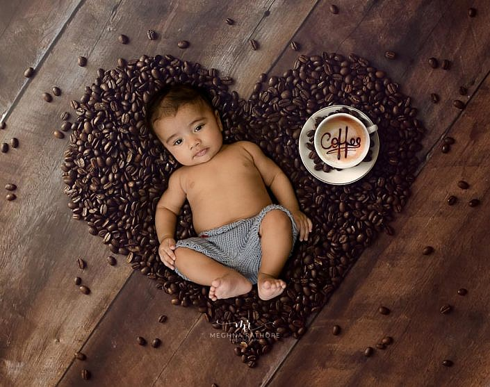 Meghna Rathore Photography, baby posing on beans