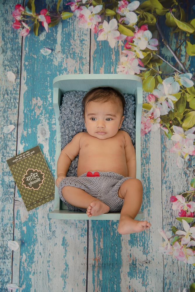Meghna Rathore Photography, newborn posing in blue bed