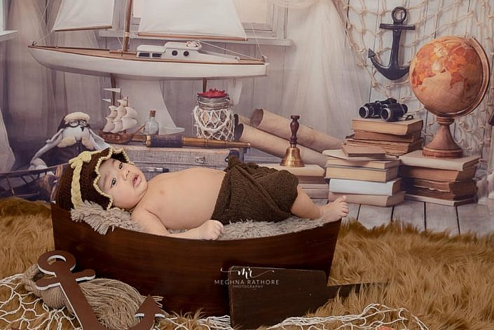 Meghna Rathore Photography, baby in boat