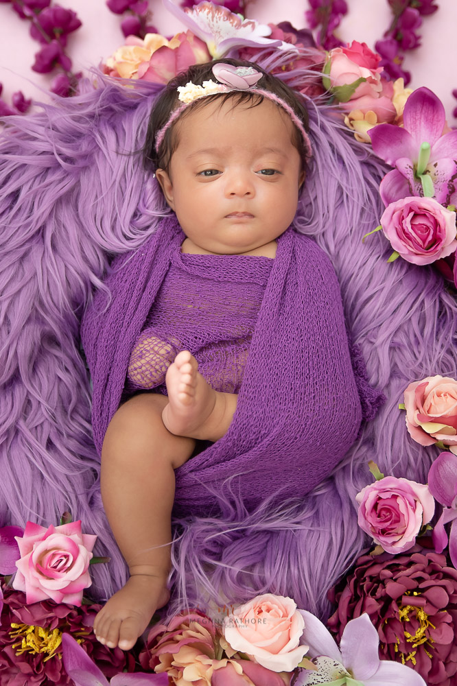 Meghna Rathore Photography, newborn baby sleeping on purple fur