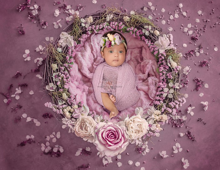 Meghna Rathore Photography, newborn posing in basket with ping florals