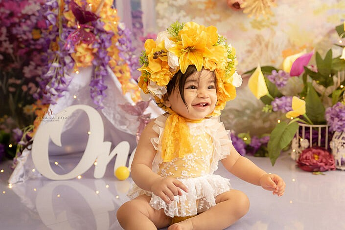 baby girl yellow dress flower head cover one prop backdrop Meghna Rathore Photography Delhi