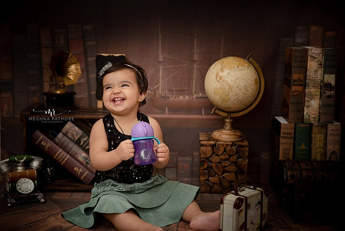 baby girl black top sipper study backdrop professional photo shoot Meghna Rathore Photography