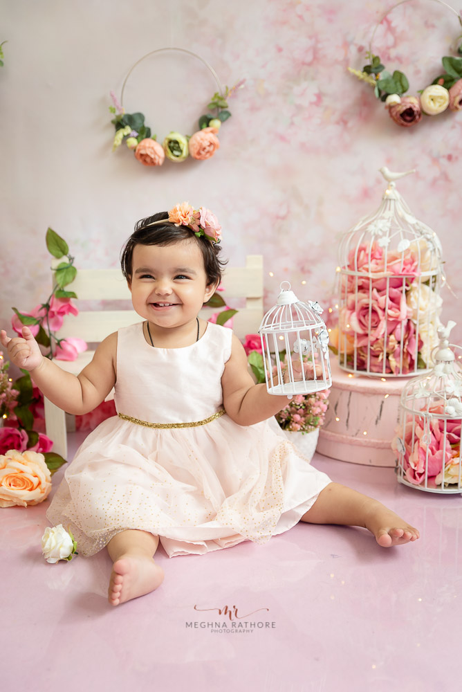 baby girl sitting white dress props decoration pink backdrop Meghna Rathore Photography