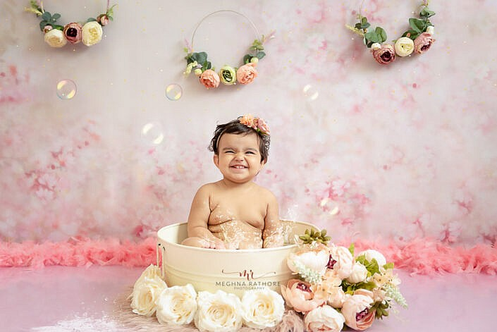 baby girl bathing in the tub floral decoration backdrop pink Meghna Rathore Photography delhi gurgaon