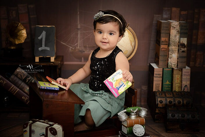 baby girl in black top profession sitter photo shoot Meghna Rathore Photography