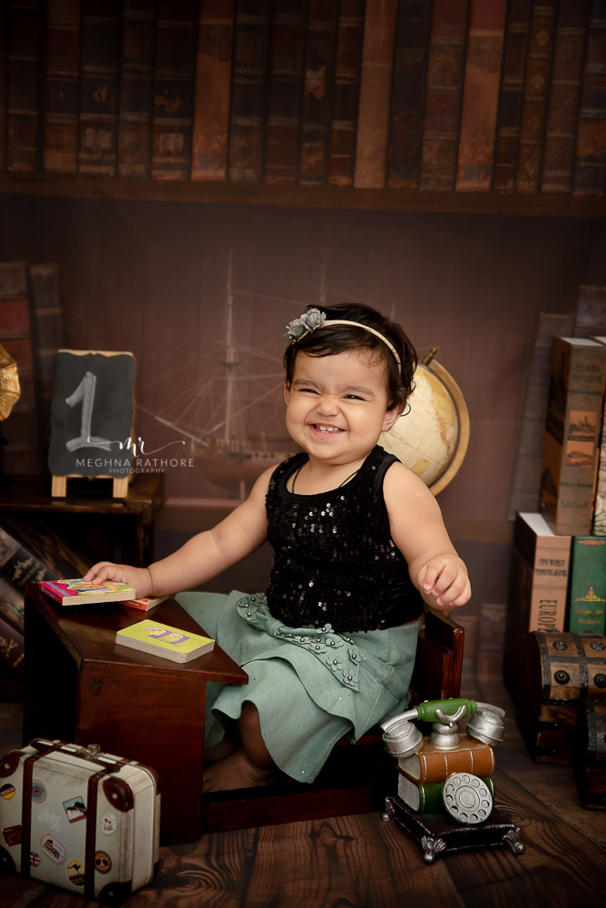 baby girl smiling phone box props study backdrop Meghna Rathore Photography