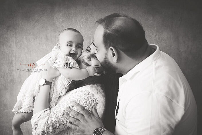 black and white pose of mom dad and baby professional family portrait Meghna Rathore Photography