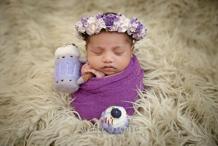 baby in a potato sack holding muffin and beer mug prop photo shoot by Meghna Rathore Photography