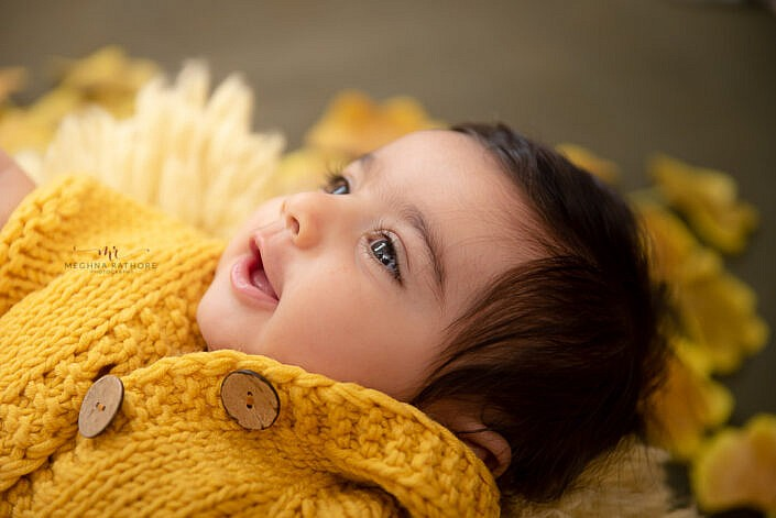 newborn baby smiling clodeup photo shoot by Meghna Rathore Photography