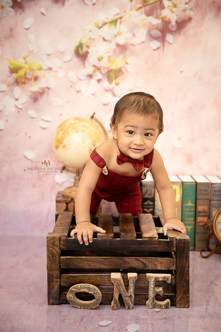 boy kid with red dress sitting in wood prop one prop study backdrop photo shoot by Meghna Rathore Photography delhi