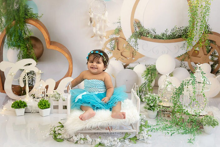 baby on white bed and laughing kid photoshoot by Meghna Rathore photography Delhi