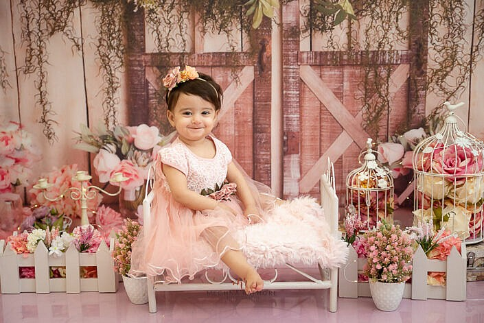 girl kid wearing pink dress pink shining floor flower decoration props photo shoot by Meghna Rathore Photography faridabad