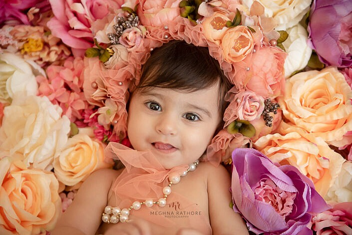 Girl kid flower decoration with cute headband smiling photo shoot by Meghna Rathore Photography Noida