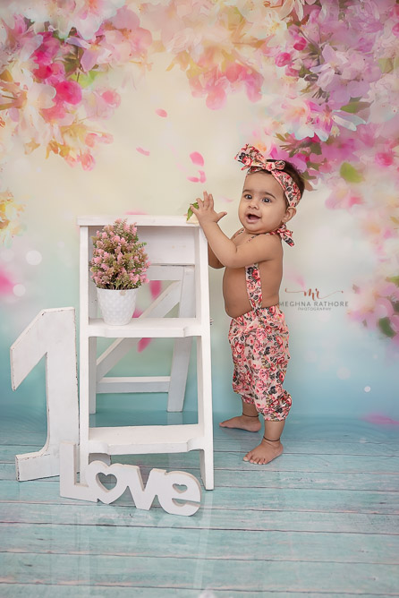 girl kid wearing cute dress with love and one prop with wooden ladder prop photo shoot by Meghna Rathore Photography noida