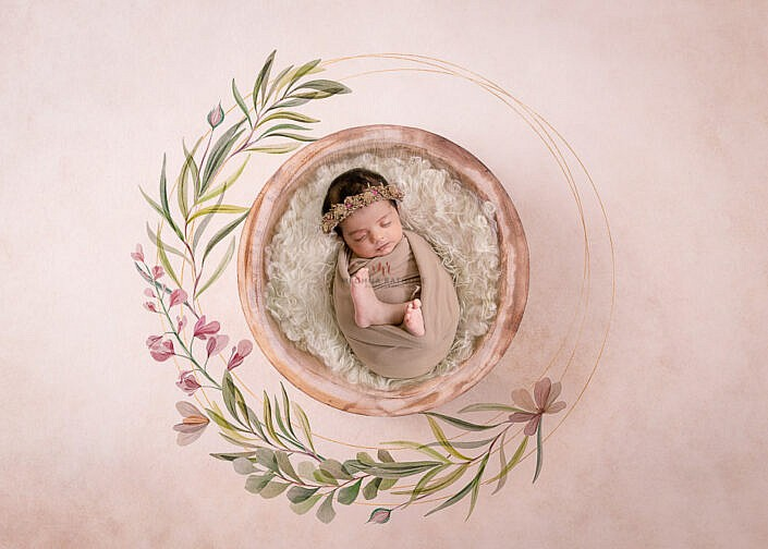 newborn baby lying in a wooden bowl wrapped in a cloth photo shoot by Meghna Rathore Photography