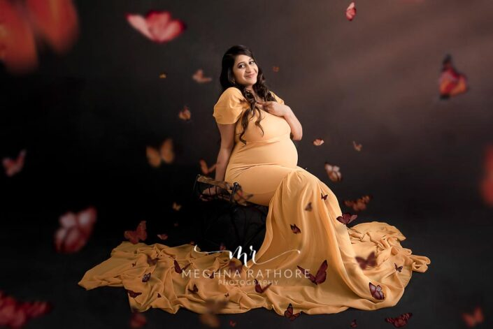 Delhi maternity photographer mom with so many butterflies a unique way of editing done on this maternity portfolio image maternity shoot by Meghna Rathore Photography