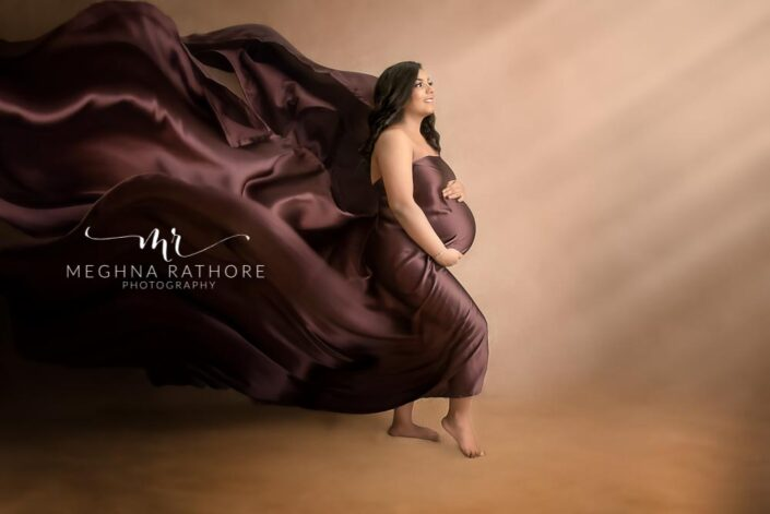 Gurgaon maternity photographer mom to be flaunting in brown drape maternity shoot by Meghna Rathore Photography