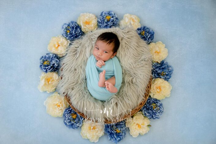 26 days old newborn baby boy in blue colored theme photo session at meghna rathore photography in delhi gurgaoni