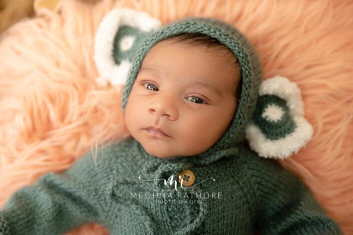 26 days old newborn baby boy posing - close up shot from the photo session held at meghna rathore photography in delhi gurgaon