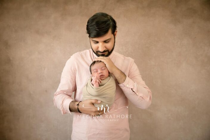Father and newborn baby boy duo posing together at meghna rathore photography in gurgaon