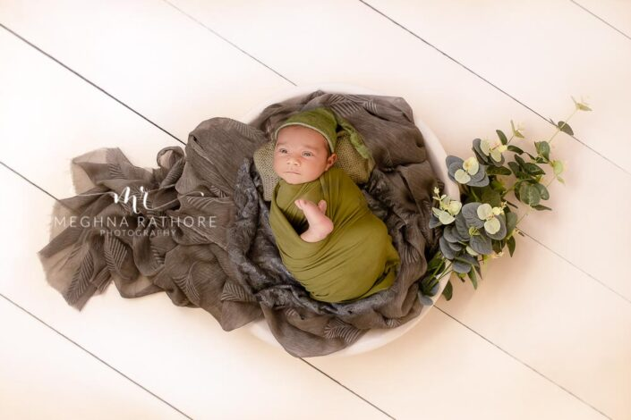newborn baby boy posing along with props at meghna rathore photography in delhi