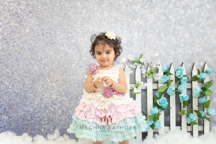 1 year old cute girl photo shoot poses in flower themed photo session for meghna rathore photography in delhi gurgaon