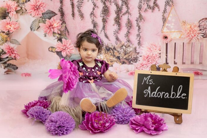 Adorable 1 year old baby girl posing in beautiful frock at meghna rathore photography in delhi gurgaon