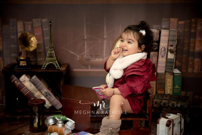 Cute 1 year old baby girl smiling and posing at meghna rathore photography in delhi and gurgaon