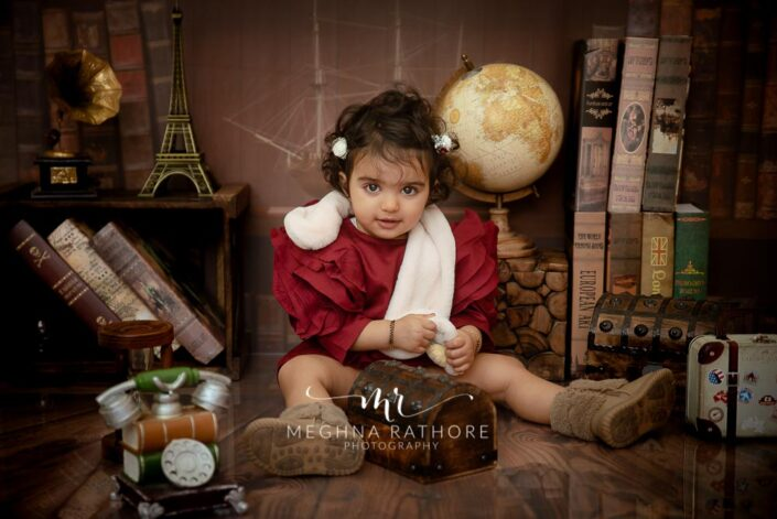 1 year old baby girl posing with theme and props at meghna rathore photography in delhi gurgaon