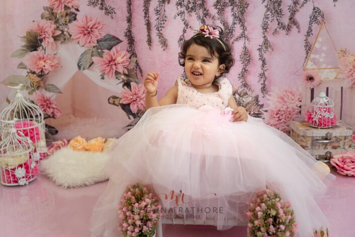 1 year old baby girl pink theme and props professional photoshoot at meghna rathore photography in delhi gurgaon