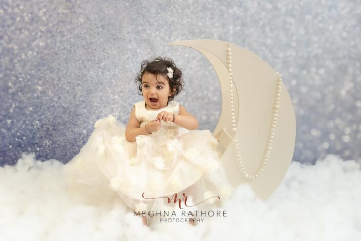 1 year old baby girl photoshoot poses with moon themed props meghna rathore photography delhi